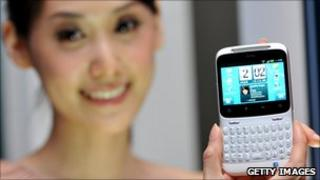 Model displays HTC phone