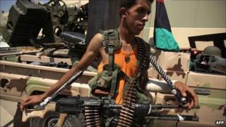 Rebel fighter near Bab al-Aziziya compound, Tripoli - 24 August 201