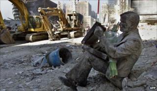 Statue in the rubble of the WTC