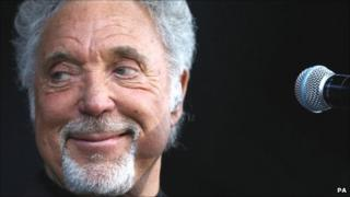 Sir Tom Jones performing at Newbury racecourse on 13 August