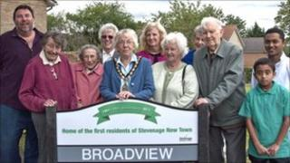 Local residents at the commemorative Broadview sign with mayor Carol Latif (centre) and council leader, Sharon Taylor (back row, right from centre).