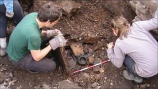 Serf archaeologists excavate the broch