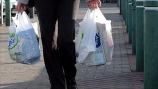 Someone carrying their shopping back to the car at the supermarket