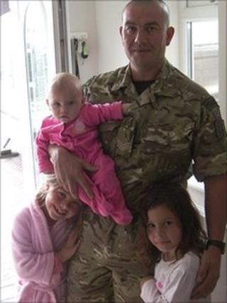 Sgt Barry Weston with his daughters
