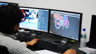 Man working on his computer at Cyberjaya