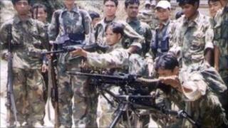 File photo of Maoist insurgents with weapons