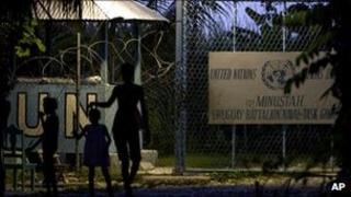 People walk in front of the UN base in Haiti where the alleged abuse took place