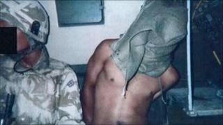 A hooded detainee in Iraq. Copyright: Baha Mousa inquiry