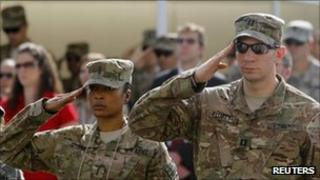 US. troops salute during an event to mark the 10th anniversary of the 9/11 attacks on the World Trade Center, at the US embassy in Kabul September 11, 2011.