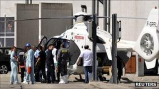 An injured person is evacuated by helicopter from the site in Marcoule, France (12 Sept 2011)
