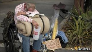 A homeless man begging for money in Los Angeles on 22 August