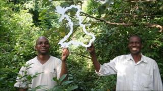 Elias Kimaru (WWF project Executive) and Sururu Lagiza from the Kaya Muhaka group within the Kaya sacred forest,