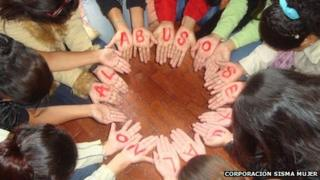 """Women in Colombia form a circle with their hands to form the message """"No to sexual abuse"""" during a self-help session in Bogota in March 2011 - photo Corporacion Sisma Mujer"""