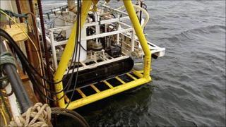 ROV being lowered from barge