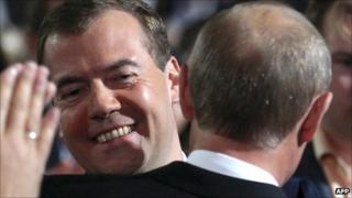 Dimitry Medvedev looks over the shoulder of Vladimir Putin at the United Russia party congress in Moscow, 24 September
