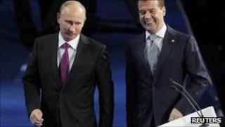 Vladimir Putin (left) and Dmitry Medvedev in Moscow, 24 September