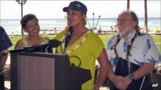 Hawaii schools superintendent Kathryn Matayoshi (L), world surf champion Carissa Moore (C) and state Governor Neil Abercrombie
