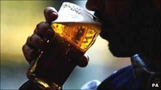 Man drinks a pint of lager in a London pub, file pic from 2007