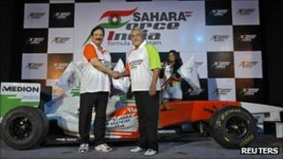 Vijay Mallya (R), co-owner of the Force India Formula One team, and Sahara Group chairman Subrata Roy