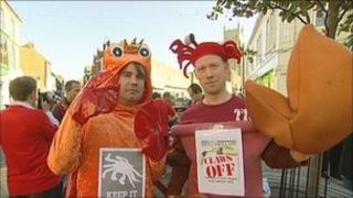 Workers dressed as crabs