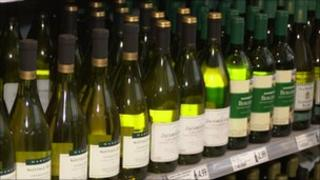 bottles of wine on supermarket shelf