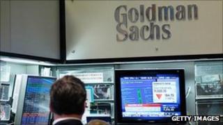 Goldman Sachs sign and trading screens