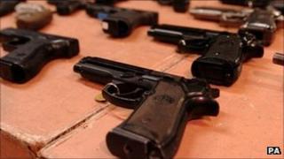 File photo of real and imitation guns, 2005