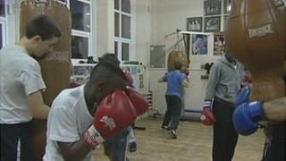 Young people boxing