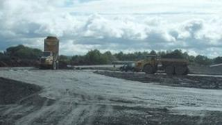Earthmovers at work on the Phoenix School site in Dawley
