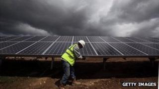 A man installing solar panels