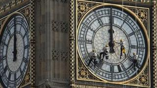 Maintenance workers on the clock face at the Palace of Westminster's Great Tower