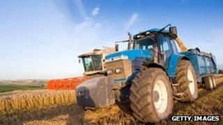 A tractor and combine harvester