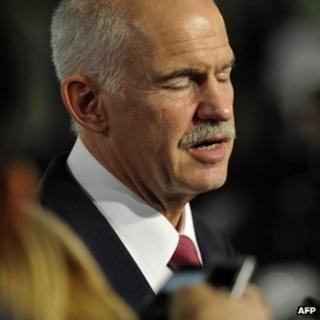 Greek Prime Minister George Papandreou talks during a press conference