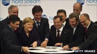 Chancellor Merkel of German, President Medvedev of Russia and other European leaders open the Nord Stream pipeline (8 November 2011)