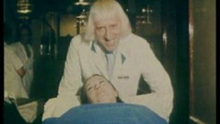 Sir Jimmy Savile working as a hospital porter