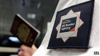 UK border official checking a passport