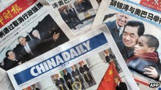 File image of the front pages of Chinese newspapers in January 2011