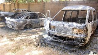 Burnt vehicles at a church compound in Nigeria's north-eastern town of Damaturu (picture taken on 8 November)