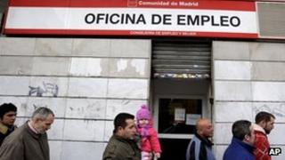 Workers queuing at a job centre in Madrid