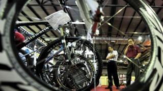 Visitors view a display of bicycles during an exhibition in Jakarta