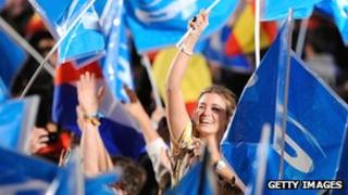 Supporters of the centre-right Popular Party celebrate following their victory in the 2011 Spanish general election