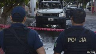 Police officers at one of the crime scenes in Culiacan