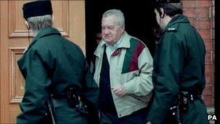 Father Brendan Smyth leaving court with two police officers