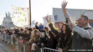 People gather at Portsmouth Naval Base to welcome home the Royal Navy warships HMS St Albans and HMS Edinburgh. Picture by Keith Morgan.