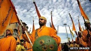 Men in Karbala dressed as troops from the Battle of Karbala