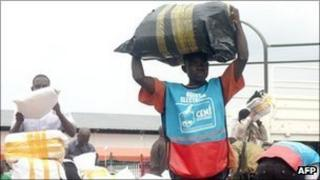 Bags of ballots are unloaded by electoral workers at the Kinshasa fair grounds on November 30, 2011 before being counted