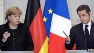 Germany's Chancellor Angela Merkel and French President Nicolas Sarkozy, 5 Dec 11