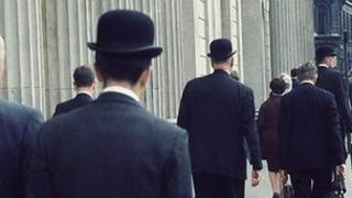 Office workers wearing bowler hats