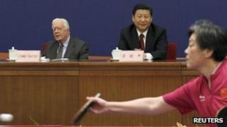 Former US President Jimmy Carter (L) sits with China's Vice President Xi Jinping during the 40th Anniversary Celebration of Ping Pong Diplomacy in Beijing, 8 December 2011