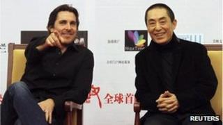 "British actor Christian Bale (L) and Chinese director Zhang Yimou attend the premiere of ""The Flowers of War"" in Beijing December 11, 2011"